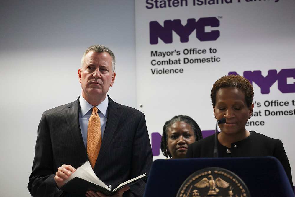 Mayor de Blasio watches as Commissioner of the Mayor's Office to Combat Domestic Violence Rosemonde Pierre-Louis speaks at the groundbreaking of the Staten Island Family Justice Center, 126 Stuyvesant Place, Staten Island, NY on Monday, Oct. 5, 2015.<br /> <br /> Andrew Hinderaker for The Wall Street Journal<br /> NYSTANDALONE