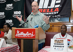 July 6, 2006 - New York, NY - Former Welterweight champions, Ike Quartey (l) and Vernon Forrest (r) listen as promoter Lou DiBella speaks during the press conference announcing their upcoming August 5, 2006 fight at the Theater at Madison Square Garden.