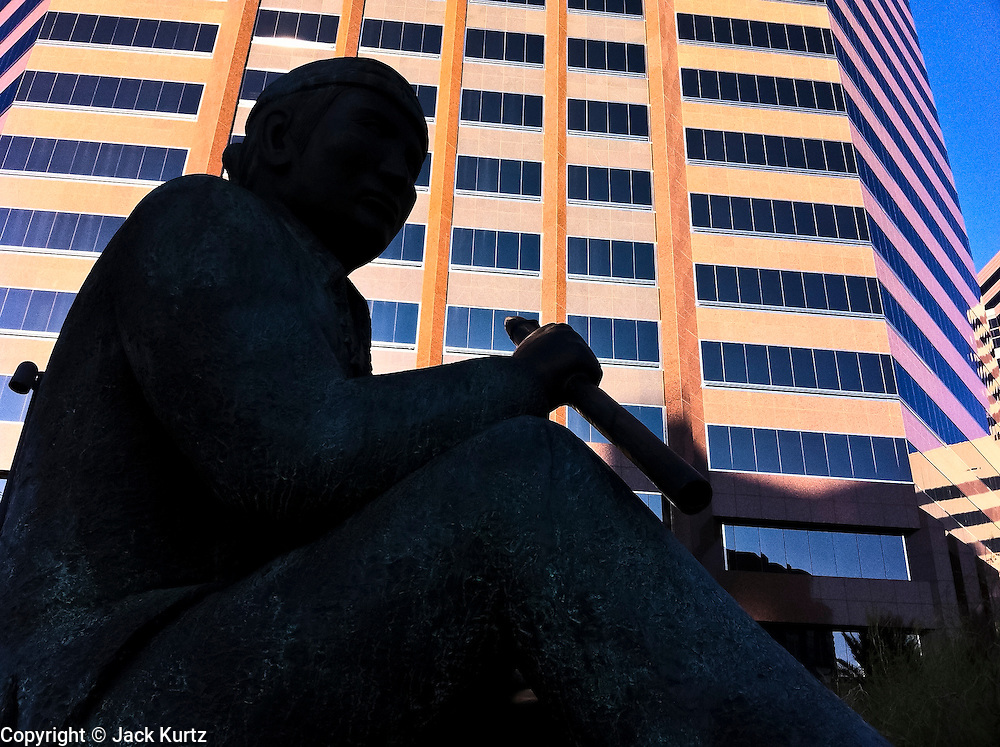 "13 NOVEMBER 2011 - PHOENIX, AZ: A monument to the World War 2 ""code talkers"" at the corner on Central Ave and Thomas Rd in Phoenix, AZ.  PHOTO BY JACK KURTZ"