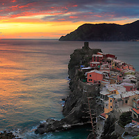 A panoramic view at sunset of Vernazza, one of the five medieval villages of the Ligurian coast altogether known as Cinque Terre.