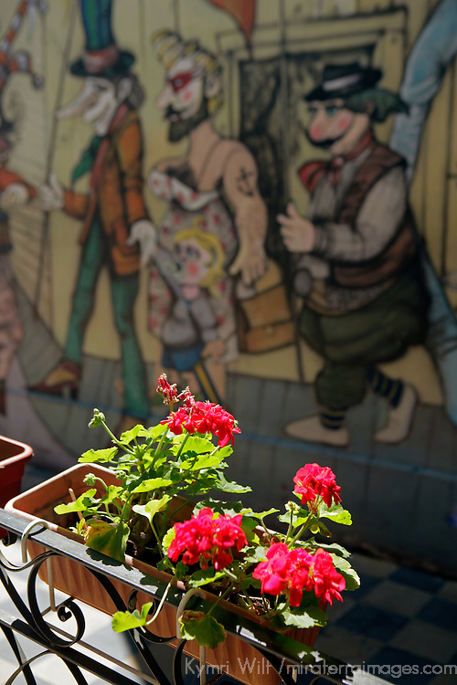 South America, Argentina, Buenos Aires. Flowers against mural in La Boca neighborhood.