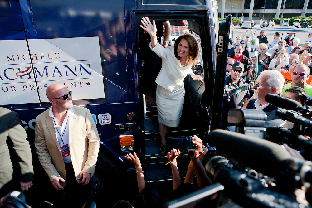 Republican presidential hopeful Michele Bachmann waves to supporters and media outside her campaign bus after winning the Iowa Republican Straw Poll on Saturday, August 13, 2011 in Ames, IA.