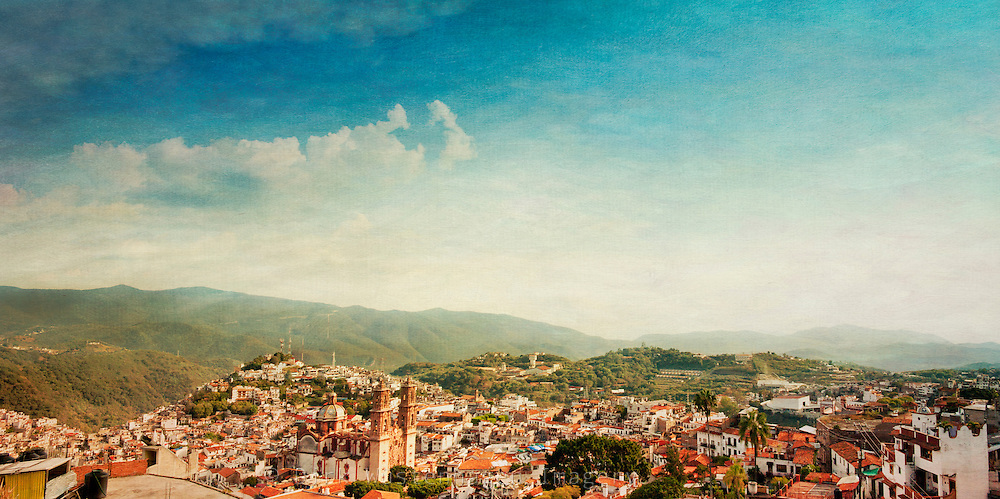 Painterly view on the town of Taxco, Maexico with the cathedral Santa Prisca on the bottom left.