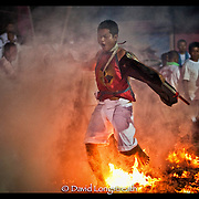 """In this """"Signature Series"""" image by David Longstreath devotees at the the Phuket, Thailand Vegetarian Festival walks on hot coals.  he annual festival in Phuket is held on a annual basis and begins usually in late September of early October depending on the lunar cycle."""