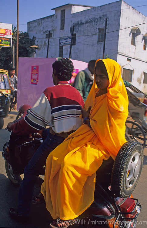 Asia, India, Rajasthan. Indian couple on a scooter.