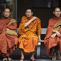 China, Hong Kong, Buddhist monks sit in Star Ferry Terminal