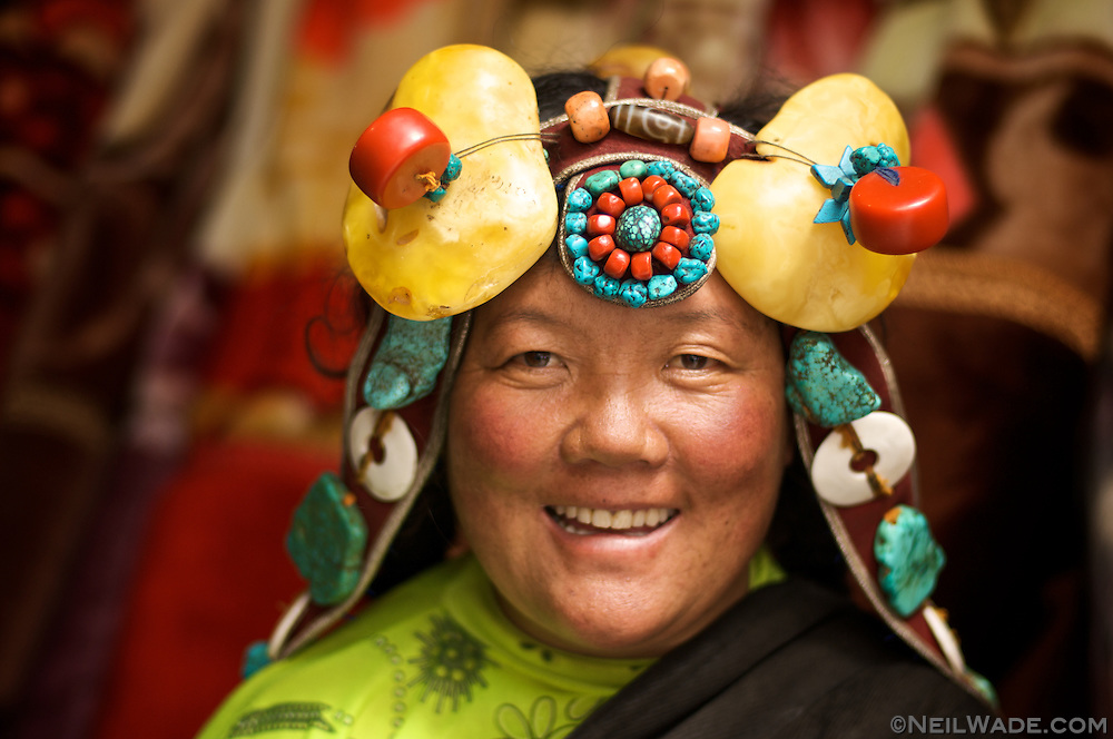 I was in Yushu just after a huge yearly horse festival. This is an exciting time for Tibetans and they will often dress to impress. This woman is wearing some very expensive (and very heavy) jewelry in her hair.