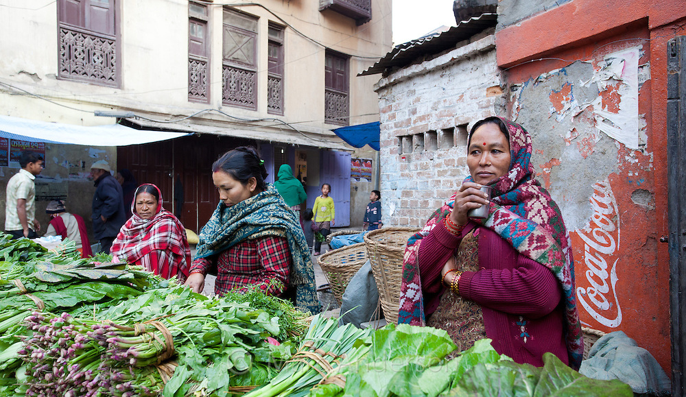 Nepali women selling green vegetables at a market in Kathmandu, Nepal