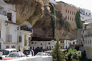 Setenil de las Bodegas. One of the Andulucian White Towns where houses are built into the tufa rock of the gorge cut by the Rio Trejo.