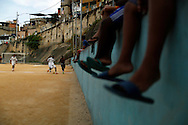 Youths play a soccer game at a rustic field during a tournament at the Sao Carlos slum in Rio de Janeiro June 7, 2014. Photo/Pilar Olivares (BRAZIL)