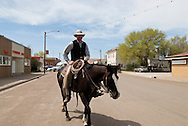 Cowboy rides through town in Circle Montana