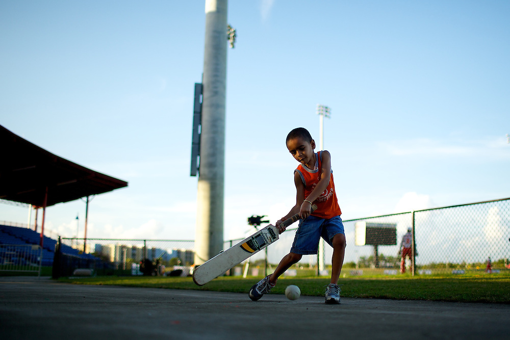 A child plays Cricket with friends between matches at the Cricket US Open in Lauderhill, Florida, Wicket, Players, Bowlers