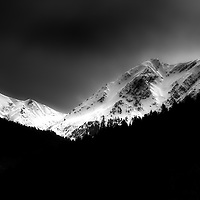 Snow covered mountain tops.