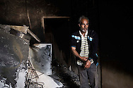 SYRIA, Idlib province: This picture shows Muhammad (45 y.o.) in his house. The Syrian man has been alleged to take part to anti-regime demonstrations, on April 11, 2012. Al Assad forces burned down his house few days before. ALESSIO ROMENZI
