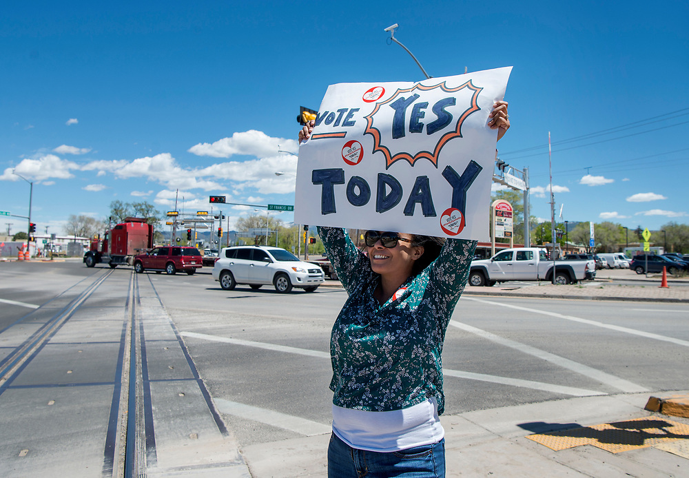 em050217c/a/Naomi Amaha-Gollnick carries a sign supporting a tax on sugary drinks to fund Pre-K education for kids in Santa Fe. This was at the corner of Cerrillos Road And St. Francis Drive in Santa Fe, Tuesday May 2, 2017. (Eddie Moore/Albuquerque Journal