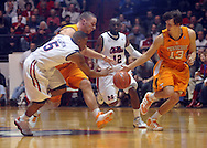 "Mississippi guard Dundrecous Nelson (5), Tennessee's Steven Pearl (22), Mississippi guard Chris Warren (12), and Tennessee's Skylar McBee (13) chase the ball  at the C.M. ""Tad"" Smith Coliseum in Oxford, Miss. on Satursday, January 29, 2011.  (AP Photo/Oxford Eagle, Bruce Newman)"