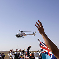 25 March 2007: The 757 participants of the 22nd Marathon des Sables waive as an helicopter is passing by at the start of the race. The Marathon des Sables is a 6 days and 151 miles endurance race with food self sufficiency across the Sahara Desert in Morocco. Each participant must carry his, or her, own backpack containing food, sleeping gear and other material.