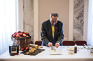 Sen. Charles Schumer prepares Hudson Valley apple pie, sour cream ice cream, aged cheese and honey, which will be served for the inaugural lunch, on Friday, January 4, 2013 in Washington, DC.