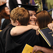 A graduate embraces her children after receiving her degree during the Graduate Commencement ceremony.<br /> <br /> Photo by Rajah Bose