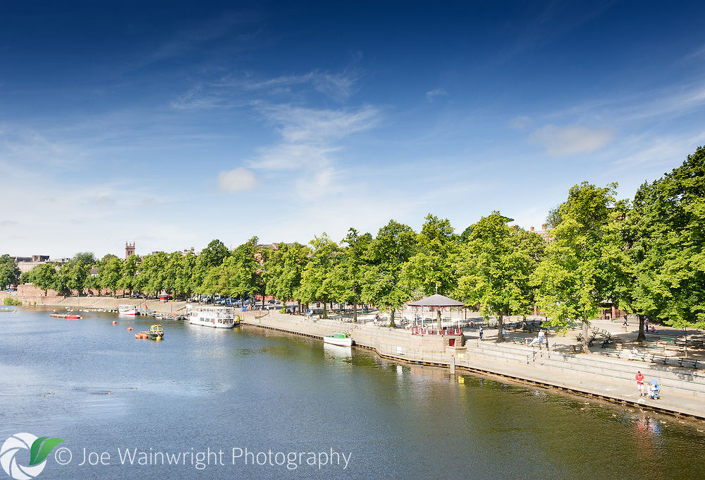 Lime trees line the popular riverside promenade of The Groves, in Chester Cheshire.