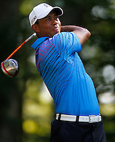 Norton, MA - Tiger Woods tees off on the ninth hole in the second round of the Deutsche Bank Championship at TPC Boston on Saturday, September 1, 2012, 2012.   Photo by Matthew Healey