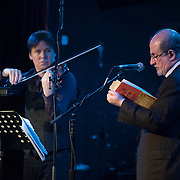 (l-r) Joshua Bell and Salman Rushdie at the 'Still Waters in a Storm' benefit at The City Winery NYC. <br /> <br /> Still Waters in a Storm is a free school for children in the neighborhood of Bushwick, Brooklyn.Volunteers offer homework help and classes in reading, writing, violin, music composition, yoga and Latin, all free of charge to low-income families in the neighborhood.