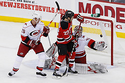 Apr 23, 2009; Newark, NJ, USA; New Jersey Devils right wing David Clarkson (23) scores a goal past Carolina Hurricanes goalie Cam Ward (30) during the second period of game five of the eastern conference quarterfinals of the 2009 Stanley Cup playoffs at the Prudential Center.