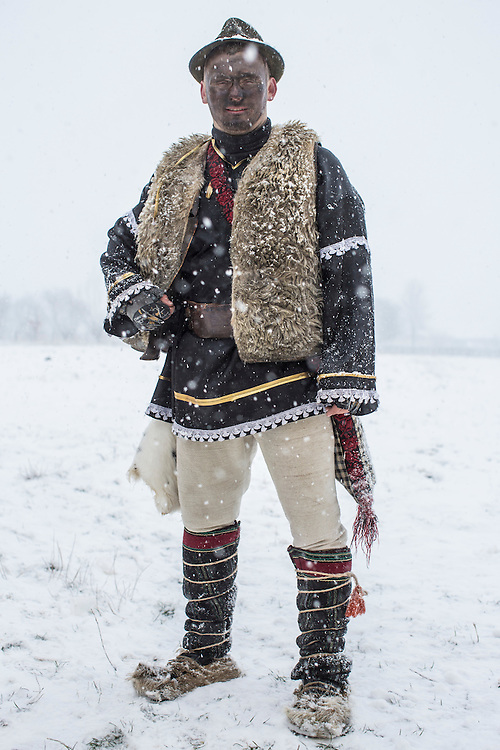 Ilya Iliuts, 21, dressed in the costume of a gypsy, poses for a portrait during celebrations of the Malanka Festival on Thursday, January 14, 2016 in Krasnoilsk, Ukraine. The annual celebrations, which consist of costumed villagers going in a group from house to house singing, playing music, and performing skits, began the previous sundown, went all night, and will last until evening.