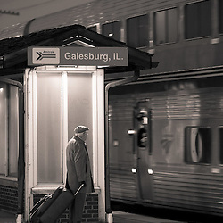 An older gentleman waits for an Amtrak train on the platform at Galesburg, IL.