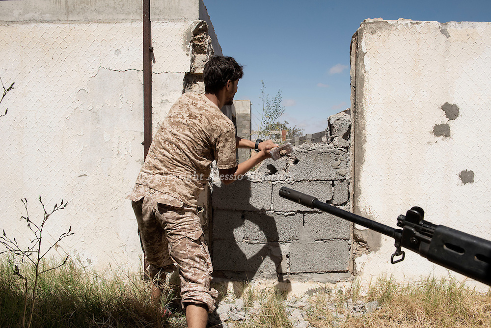 Libya: to avoid ISIS sniper fire Libya's Government of National Accord's (GNA) fighters open a passage breaking a wall in 700 neighbourhood in Sirte still under ISIS control. Alessio Romenzi