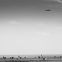 The space shuttle Endeavor makes its final flight over famed Malibu Beach on its farewell tour culminating in Los Angeles. Photographed for Aurora Photos.