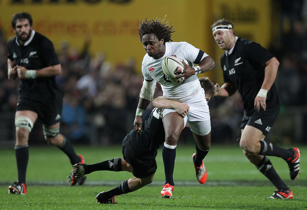 New Zealand's Beauden Barrett tackles England's Marland Yarde in an International Rugby Test match, Waikato Stadium, Hamilton, New Zealand, Saturday, June 21, 2014.  Credit:SNPA / David Rowland