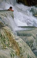Woman bathing in Saturnia termal waters.