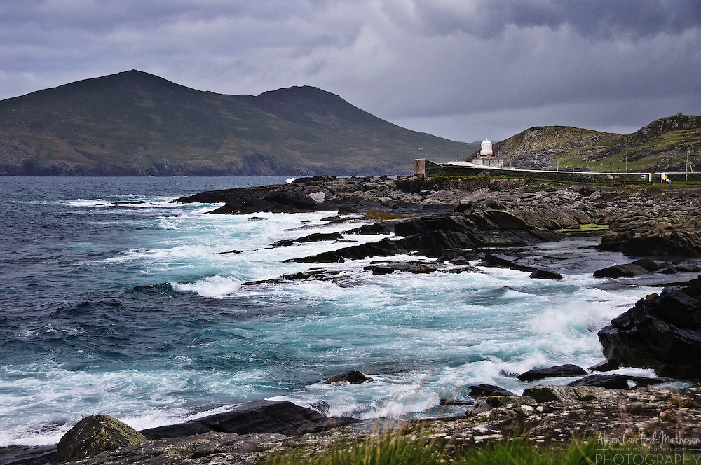 Cromwell Point Lighthouse, Valentia Island with a background view of Killelan Mountain and Beginish Island