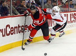 February 13, 2008; Newark, NJ, USA;  New Jersey Devils defenseman Johnny Oduya (29) skates around a check by Ottawa Senators left wing Dany Heatley (15) during the first period at the Prudential Center in Newark, NJ.