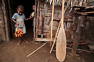"""Every morning the children of Lutes village wait at the baker's house for the local dohnuts, called """"Kado"""". Uleveo, Maskelyne Island, Malampa Province, Malekula, Vanuatu"""
