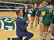 Nov. 21, 2015: UAA outside hitter Katelynn Zanders (14) is surprised by boyfriend Jacob as he proposes to her on senior night after the UAA vs. Western Oregon match.