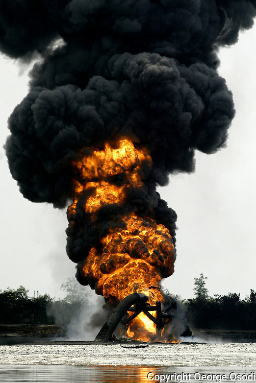Smoke and flames billow from a burning oil pipeline belonging to Shell Petroleum Development Company across the Opobo Channel in Asagba Okwan Asarama about 50km south-west of Port Harcourt, Nigeria, Thursday, Dec. 22 2005.Investigators are probing the source of a fire that was still blazing Wednesday on a ruptured Royal Dutch Shell oil pipeline in southern Nigeria as the company announced further petroleum production cuts.Residents near the conduit in Nigeria's strife-riven south said suspected militia fighters blew up the pipeline southwest of Port Harcourt Tuesday with dynamite, sparking a conflagration that killed eight.(AP Photo/George Osodi).