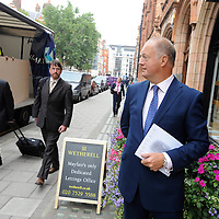 UK. London. Mayfair, the heart of London's banking and Hedge Fund business. An estate agent outside his shop.