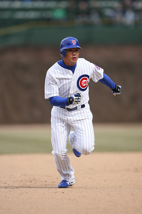CHICAGO - APRIL 4:  Kasuke Fukudome #1 of the Chicago Cubs runs the bases during the game against the Houston Astros at Wrigley Field in Chicago, Illinois on April 4, 2008.  The Astros defeated the Cubs 4-3. (Photo by Ron Vesely)