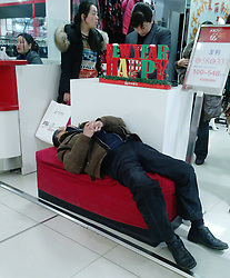 File photo taken on Jan. 2, 2013 shows a citizen sleeping at a shopping mall in Nanjing, capital of east China s Jiangsu Province. March 21 marks the World Sleep Day, which is an annual event intended to be a celebration of sleep and a call to action on important issues related to sleep.. Photo by Imago / i-Images...UK ONLY.