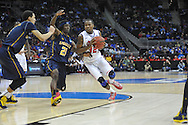 Ole Miss' LaDarius White (10) vs. La Salle's Tyronne Garland (21) in the Round of 32 of the NCAA Tournament at the Sprint Center in Kansas City, Mo. on Sunday, March 24, 2013.