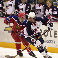 FROM LEFT-Team Russia's Violetta Simanova fights for the puck against Team USA's Angela Ruggiero during the second period of semi final play at the 2001 Women's World Hockey Championships at Mariucci Arena in Minneapolis on Saturday, April 7, 2001.(AP Photo/Adam M. Bettcher)