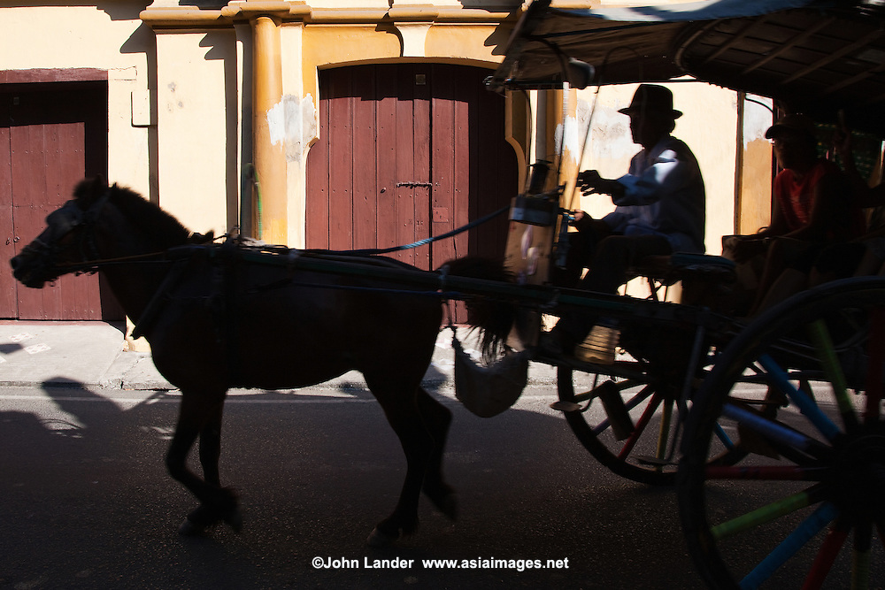 Vigan Calesa Silhouette - A calesa is a horse-driven carriage used in the Philippines. This was one of the modes of transportation introduced in the Philippines in the 18th century by the Spanish - at the time only nobles and high ranked officials could afford. They are rarely used in the streets nowadays except rural areas and especially in Vigan where they are still a common form of transportation.