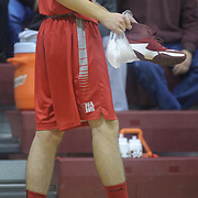 Hazleton Cougars Nolan Genasevich (25) walks off the court holding a bag of ice and his sneaker after getting injured  during the Concord Classic basketball game between Mount Pleasant and the Hazleton Cougars Mon. Jan. 16, 2017 at Concord High School in Wilmington.