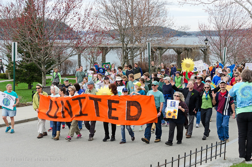 Bar Harbor, USA. 29 April, 2017. Protesters in the Downeast Climate March, a sister march to the People's Climate March in Washington, D.C., walk up Main Street.