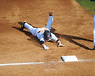 Ole Miss' Tanner Mathis steals second vs. North Carolina-Wilmington and goes to third on an error  at Oxford-University Stadium in Oxford, Miss. on Saturday, February 25, 2012. Ole Miss won 6-4.
