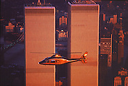 NYC, NY, Helicopter, Golden Twin Towers, World Trade Center, designed by Minoru Yamasaki, International Style II, sunset