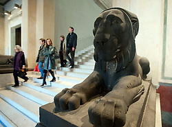 Lion statue at base of main staircase inside Neues Museum or New Museum on Museumsinsel or Museum Island in Berlin
