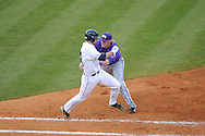 Ole Miss' Sikes Orvis is out at first vs. TCU's Kevin Cron at Oxford-University Stadium in Oxford, Miss. on Friday, February 15, 2013. Ole Miss won the season opener 1-0.